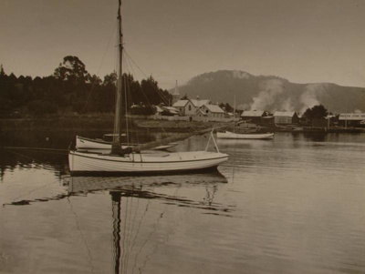 View of boats moored in Lake Rotorua with Saint Mi...