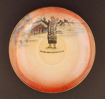 Round raised saucer. Gold leaf rim, colour illustr...