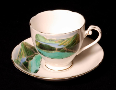 A set of white fine bone china souvenir cup and sa...