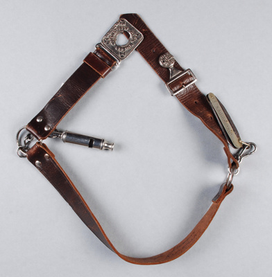 A three section leather belt is joined by large st...