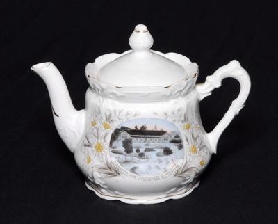 Small white china teapot with scalloped neck and b...