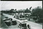 Carnival float parading along Tutanekai Street, Rotorua, Circa 1930, GP 788
