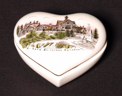 Heart shaped china trinket box. Gold leaf along ed...