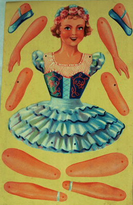 A paper 'cut out' girl on a card. The aim of the g...