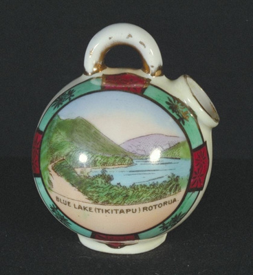 This souvenir ware china has gold leaf, a ball lik...