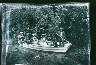 View of a group in a boat at Hamurana with a man u...