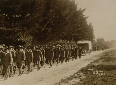 View of an Anzac Day parade marching east on Arawa...