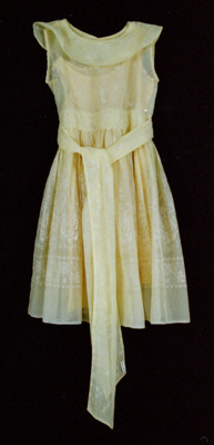 This yellow flocked nylon dress features a wide sc...