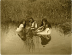 Three girls sitting in water; Edward W Payton; 1917; OP-1775