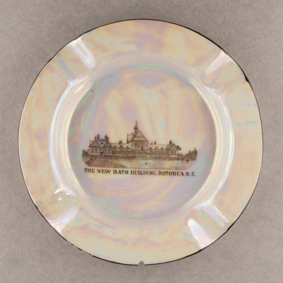 This souvenir ware china plate features a lustrous...