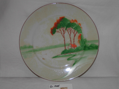 Painted plate with trees, a red roof house and river; 1977/1985/1