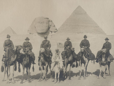 WWI. A group of soldiers mounted on camels in fron...