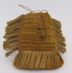 Kete, square shaped with a  fringe on the side and bottom. ; 1880-1890; 1954-332-0001