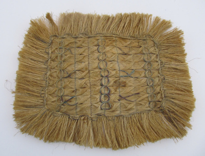 Rectangular in shape, it has a fringe around the e...