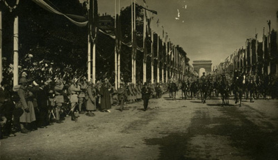 A view of troops coming down the Avenue de Champs ...