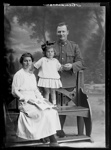 Group portrait of an unidentified soldier, an unidentified woman and an unidentified girl [inscribed Henderson] ; Berry & Co; 1914-1919; B.046481
