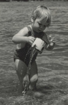 Young girl standing in shallow waters ; Lee-Johnson, Eric; 1950s; O.006744