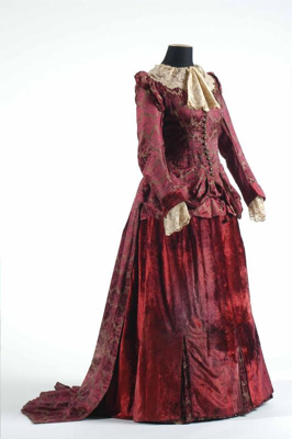 A woman's two piece burgundy and donkey brown silk...