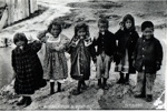 A haka for a penny. Mairi children at Whakarearewa village.; 246
