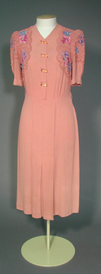This 1943 pink day dress is typical of wartime fas...