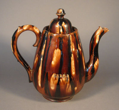 This large mottled brown teapot made by Milton Pot...