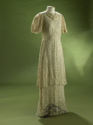 This mid 1930s evening gown is made from a synthet...