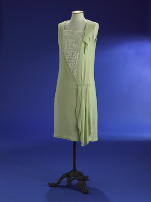 This 1920s day dress in apple green crepe epitomis...