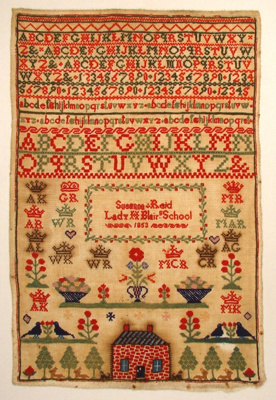 This sampler has a plain weave cotton ground embro...