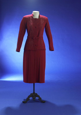 This smart fuchsia wool crêpe suit dates from the...