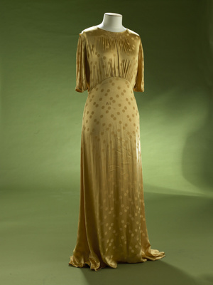 This sinuous evening gown is made from a synthetic...