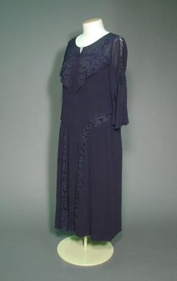 This early 1930s dress mixes navy blue silk george...