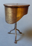 Cap on stand made from a shell case; 224/1