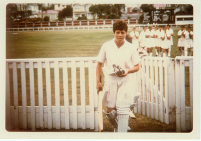Photo: Trish McKelvey walking off field after making 155*, Basin Reserve 1966; Kodachrome Print by Kodak; 1966; 2018.5.40