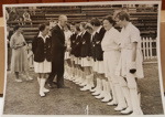 Photograph:NZ Women's team lined up to meet unknown official while on tour in England. Date unknown c.1950s ; Circa 1950s ; 2017.32.35