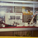Photograph: 'Men in White' display cabinet, possibly at Shell Head Office; Shell Photographic Unit; c1990s; 2018.14.6