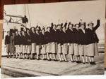 Photograph: NZ women's cricket team pose with arms in the air on-board ship. ; Circa 1950s ; 2017.32.36