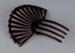 Comb, Peineta, Brown celluloid; Unknown maker; 1880-1940; RI.W2002.1604