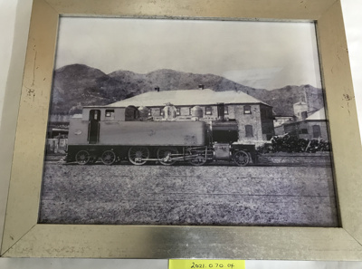 Photograph, Train Engine outside A & G Price; A & G Price Ltd; 2021.070.04
