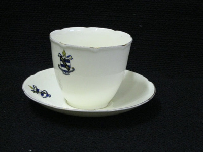 Royal Doulton cup and saucer set with School coat ...