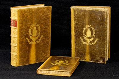 Leather bound books featuring the original School crest embosed in gold on the cover. As awarded to students as accademic prizes. Each book has a plaque inside the cover with the prize winners name and subject and is signed by the headmaster of the day. There are over 65 in the collection dating from 1886; 1886 - 1951 inclusive; 2010/5 etc