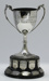 Trophy #046 Base was originally Senior Tennis Singles Championship  awarded intermittently 1908- 1950  - new cup added 1967 for Junior Discus