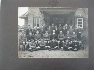 1922 Day Boys and Housemaster G F McGrath in front...
