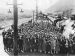 Overview of train and many assembled passengers at Paekakariki Station.     ; 002