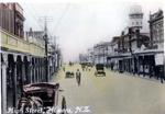 Semi coloured photograph of High St Hawera,; H.J.Finlay.; 2013.067