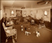 """Photograph: Children's Play-Room -  """"A"""" Deck. Walnut dado, Painted Walls and Cane Furniture; Shaw Savill & Albion Company; Stewart Bale Ltd; 1994.279.21"""