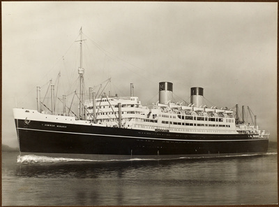Photograph in album: Q.S.M.V. DOMINION MONARCH  by Messrs. Shaw Savill & Albion Co. Ltd.; Shaw Savill & Albion Company; Stewart Bale Ltd; 1994.279.2