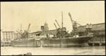 Photograph: Six cranes working SS DURHAM, 1922.; Auckland Harbour Board. Engineer's Dept.; 2010.132.302