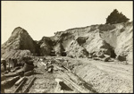 Photograph: Cutting down Campbell's Point, St. George's Bay reclamation, 1916.; Auckland Harbour Board. Engineer's Dept.; 2010.132.352