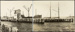 Photograph: Collier KAKAPO (1901) and scow ALERT (1901) alongside new Devonport cargo wharf, 1928.; Auckland Harbour Board. Engineer's Dept.; 2010.132.155