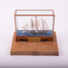 Small model of a sailing ship in a glass case (ANN GAMBLES); 2017.8.2